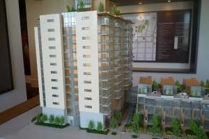 Model of a concrete condominium building called James.