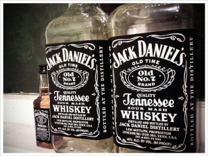 Jack Daniel's bottles. 2 empty, one full