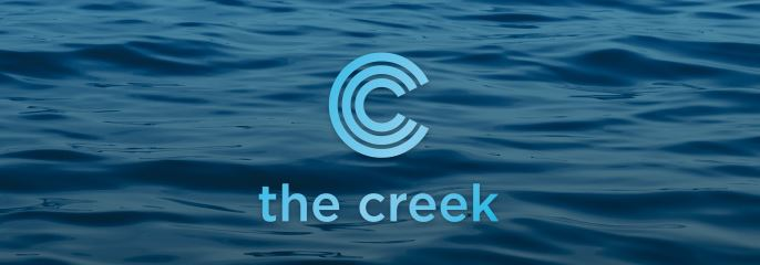logo the creek by concert properties